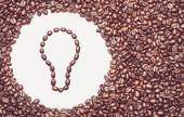 Coffee texture with a lightbulb symbol — Stock Photo