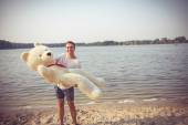 Guy with a big teddy bear — Stock Photo