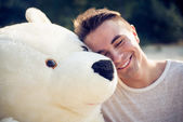 Guy with a big teddy bear — Stock Photo