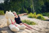 Beautiful pregnant woman with a teddy bear — Stock Photo