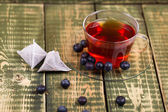 Fruit tea with cake blueberry berries — Stock Photo