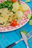Closeup of roast turkey with potatoes and rucola, tomatoes on blue wooden table — Stock Photo