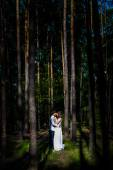 Young happy loving couple enjoy a moment of happiness in forest. Black and white. — Stockfoto