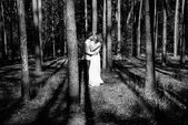 Young happy loving couple enjoy a moment of happiness in forest. Black and white. — Stock Photo
