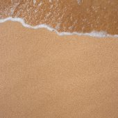 Frame from sand and waves on the beach — Stock Photo