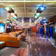 Cruise ship's main promenade deck. Different colorful lights making romantic ambiance. — Stock Photo #73566177