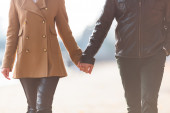 Couple is holding each other hands — Stock Photo