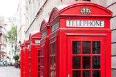 Traditional red telephone booths in London — Stock Photo