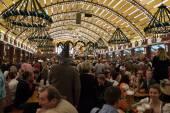 Celebration at the Oktoberfest inside a bavarian tent. — Stock Photo