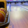Colorful bowling balls in front of tenpin alley — Stock Photo #73667481