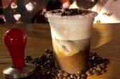 Fresh take away coffee with cream coffee beans — Stock Photo