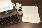 Typewriter coffee and paper — Stock Photo