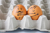 Two  eggs hugging  couple in empty carton — Stock Photo