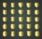 Zlatý štít sadu návrhů s různými tvary. — Stock vektor