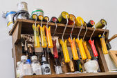Tools of the artist on the shelf in the workshop — Stock Photo