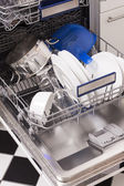 Dishwasher loades in a kitchen with clean dishes — Stock Photo