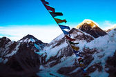 Everest from Kalapathar tops lighting evening sun with Buddhist  — Stock Photo