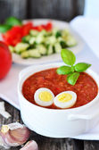 Salmorejo Spanish vegetable soup with quail egg on the old wood table — Stock Photo