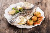 Baked fish dorado with vegetables — Stock Photo