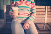 Woman with cup of coffee and digital tablet on bench — Stock Photo