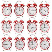 Twelve alarm clocks — Stock Photo