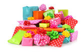 Colored gift boxes with decorative bows — Stock Photo