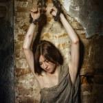 Girl prisoner, slave medieval, in the basement  in shackles — Stock Photo #75065729