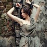 Girl prisoner, slave medieval, in the basement  in shackles — Stock Photo #75065747