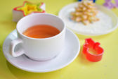Image of tea, tasty cookies and molds — Stock Photo