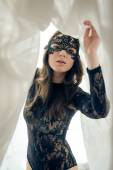 Beautiful lady with perfect fit body in black combies dress & mask — Fotografia Stock