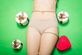 Luxury gift boxes lying near beautiful sexy female hips — Stock Photo