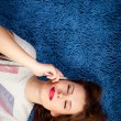 Picture of sexy young beautiful woman relaxing over blue copy space and talking on mobile phone — Stock Photo #79396374