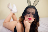 Close up portrait of sexy mysterious young pretty lady in bunny ears mask relaxing in bed — Stock Photo