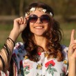 Happy young girl hippie smiles and showing sign of peace Outdoors — Stock Photo #76600317
