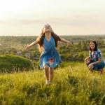 Little girl running on meadow — Stock Photo #74353201