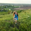 Little girl running on meadow — Stock Photo #74353265
