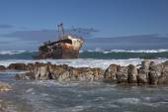 Shipwreck on rocks — Stock Photo