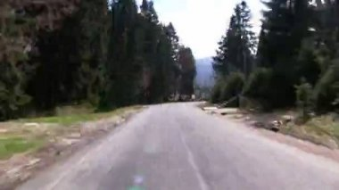 Sinuous road  ending at gas station — Stock Video