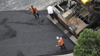 Construction team  asphalting road — Stock Video