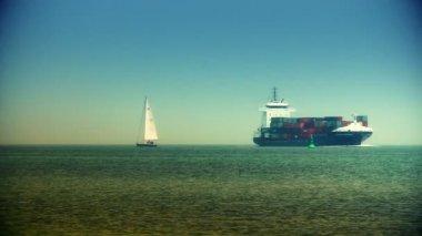 Cargo ship meets boat — Stock Video