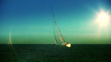 Yacht sailing at sundown — Stock Video