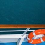 Постер, плакат: Life Preserver on Dock Overlooking Sea Water