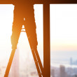 Silhouette of Construction Worker on Ladder — Stock Photo #74947111