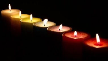 Group of coloured Candles with flame. — Stock Video