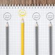 Pencils, cheerful yellow smile and sad gray smiles — Stock Photo #77804074