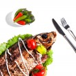 Dish of fried fish with vegetables — Stock Photo #74378543