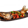 Dish of fried fish with vegetables — Stock Photo #75499397