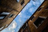 Houses against blue sky — Stock Photo