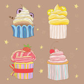 Four cupcakes — 图库矢量图片