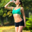 A sport girl drinks water — Stock Photo #80728362